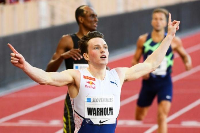 Le Norvégien Karsten Warholm vainqueur du 400 m haies au meeting de Monaco, le 9 juillet 2021 (AFP - CLEMENT MAHOUDEAU)